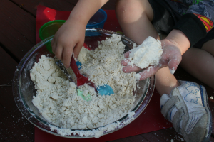 Close up of child playing with 2 ingredient moon sand