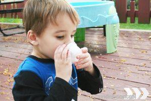 child sniffing smelling jars