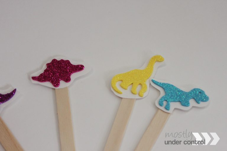 3 glitter stickers on craft sticks - pink, yellow and blue.
