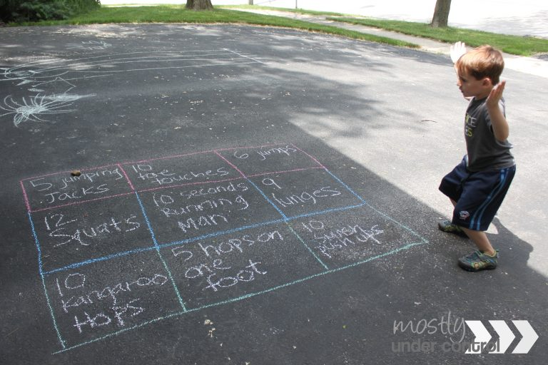 Child doing action words as a sidewalk chalk game