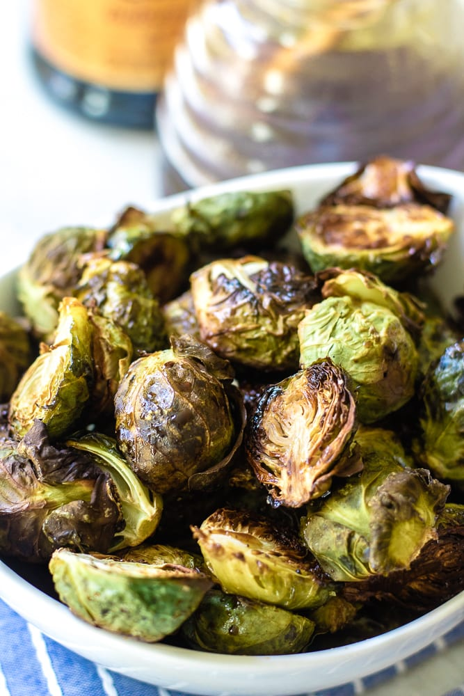 Close up view of oven roasted brussel sprouts with balsamic glaze.