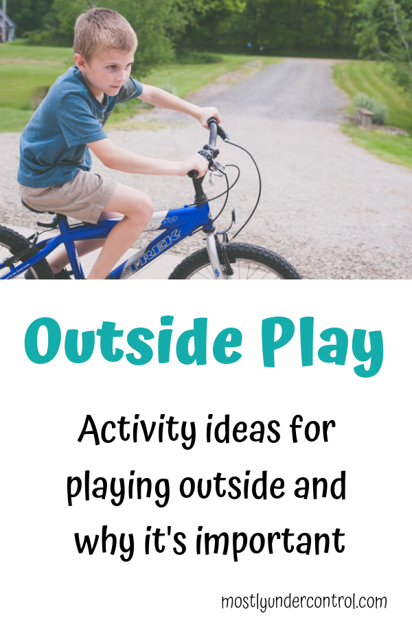 photo of child on a bike with text - outside play. Activity ideas for playing outside and why it's important.