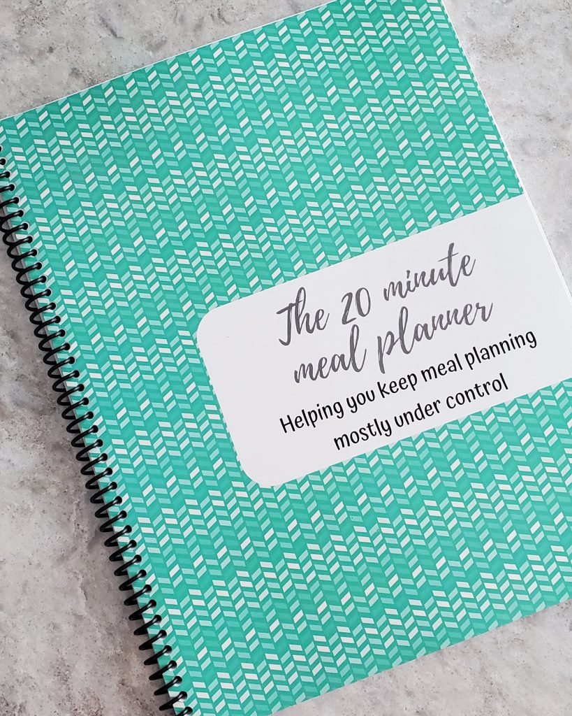 Teal cover for the weekly meal planner with grocery list